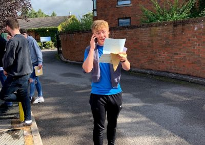 Boy on phone GCSE results